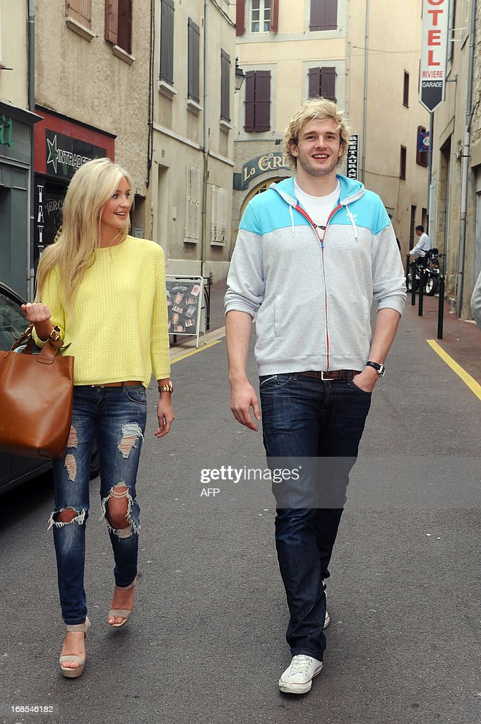 Scottish rugby player <a gi-track='captionPersonalityLinkClicked' href=/galleries/search?phrase=Richie+Gray+-+Rugby+Player&family=editorial&specificpeople=5907993 ng-click='$event.stopPropagation()'>Richie Gray</a> poses with his girlfriend in Castres, southern France on May 2, 2013. After one season playing for the Sale Sharks, Gray signed on May 3 a three-year contract with Castres, currently ranked 4th in the Top 14, Gray told AFP. 23-year-old Gray will replace Samoan Joe Tekori, who will join Stade Toulousain next season.
