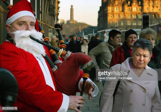 A Scottish santa plays the bagpipes for Christmas shoppers in Princes Street Edinburgh after a survey by theology think tank Theos found that the...