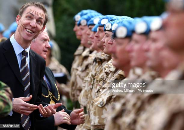 Scottish Secretary of State Jim Murphy speaks with territorial soldiers from the 32 signal regiment group as they are presented with their United...
