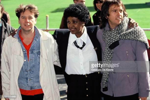 Scottish singer Jim Kerr of Simple Minds Winnie MadikizelaMandela and English singer Peter Gabriel attend backstage a concert held at Wembley Stadium...