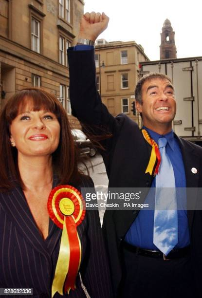 Scottish Socialist party leader Tommy Sheridan and his wife Gail arrive at the press conference in Glasgow after the elections Mr Sheridan vowed his...