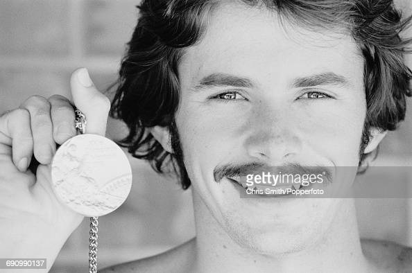 Scottish swimmer David Wilkie competing for the Great Britain team holds his gold medal after finishing in first place in the final of the Men's 200...