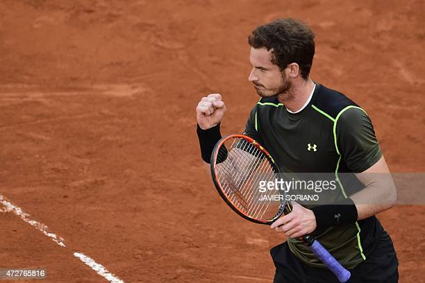 Scottish tennis player Andy Murray celebrates a point against Japanese tennis player Kei Nishikori during the men semifinal of Madrid Open tournament...