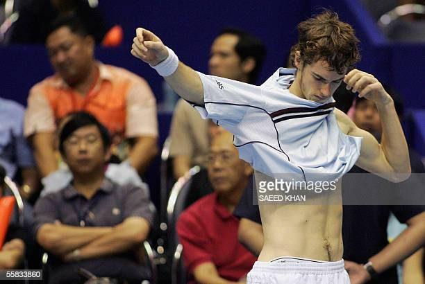 Scottish tennis player Andy Murray changes his shirt to play the third and decisive set against Thailand's Paradorn Srichaphan in the second...