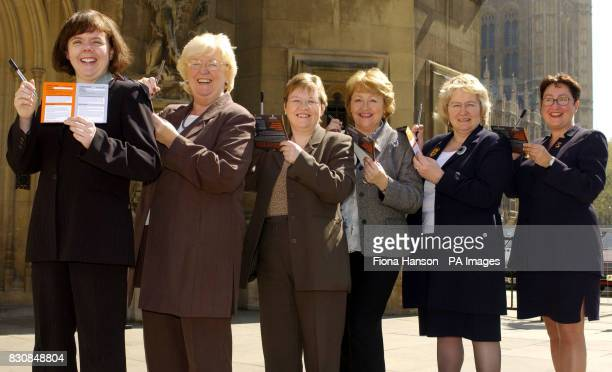 Scottish women Labour MP's except Annabelle Ewing who represents the Scottish National Party gather outside the House of Commons London on Wednesday...