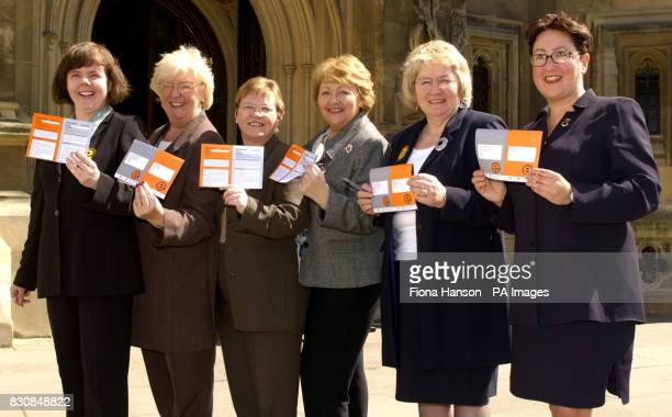 Scottish women Labour MP's except Annabelle Ewing who represents the Scottish National Party gather outside the House of Commons London to sign...