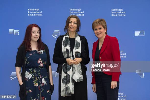 Scottish writer Heather McDaid Turkish author Elif Shafak and Scotland's First Minister Nicola Sturgeon attend a photocall during the annual...