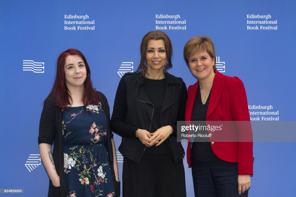 Scottish writer Heather McDaid, Turkish author Elif Shafak and Scotland's First Minister Nicola Sturgeon attend a photocall during the annual Edinburgh International Book Festival at Charlotte Square Gardens on August 18, 2017 in Edinburgh, Scotland.