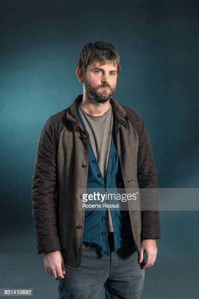 Scottish writer Martin MacInnes attends a photocall during the annual Edinburgh International Book Festival at Charlotte Square Gardens on August 14...