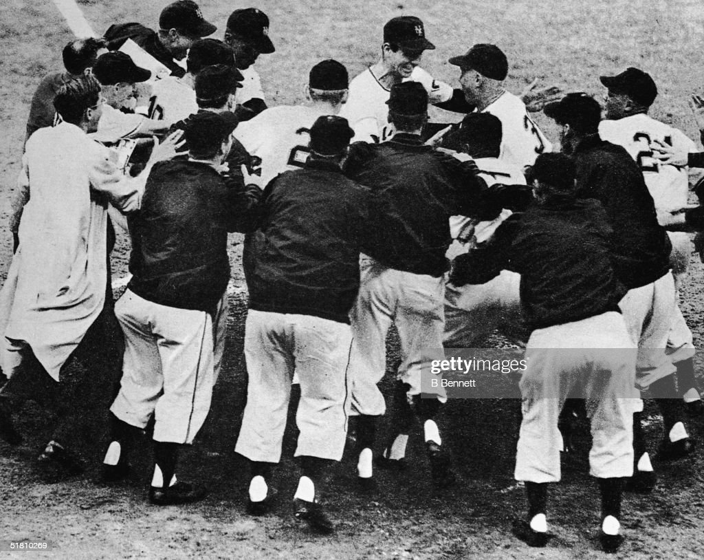 Scottishborn American professional baseball player Bobby Thomson is mobbed by happy teammates after he hit the 'Shot heard 'round the world' homerun...