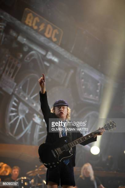 Scottishborn guitarist Angus Young of the hard rock band AC/DC performs at the Palais Omnisport of Paris Bercy on February 25 in Paris The band will...