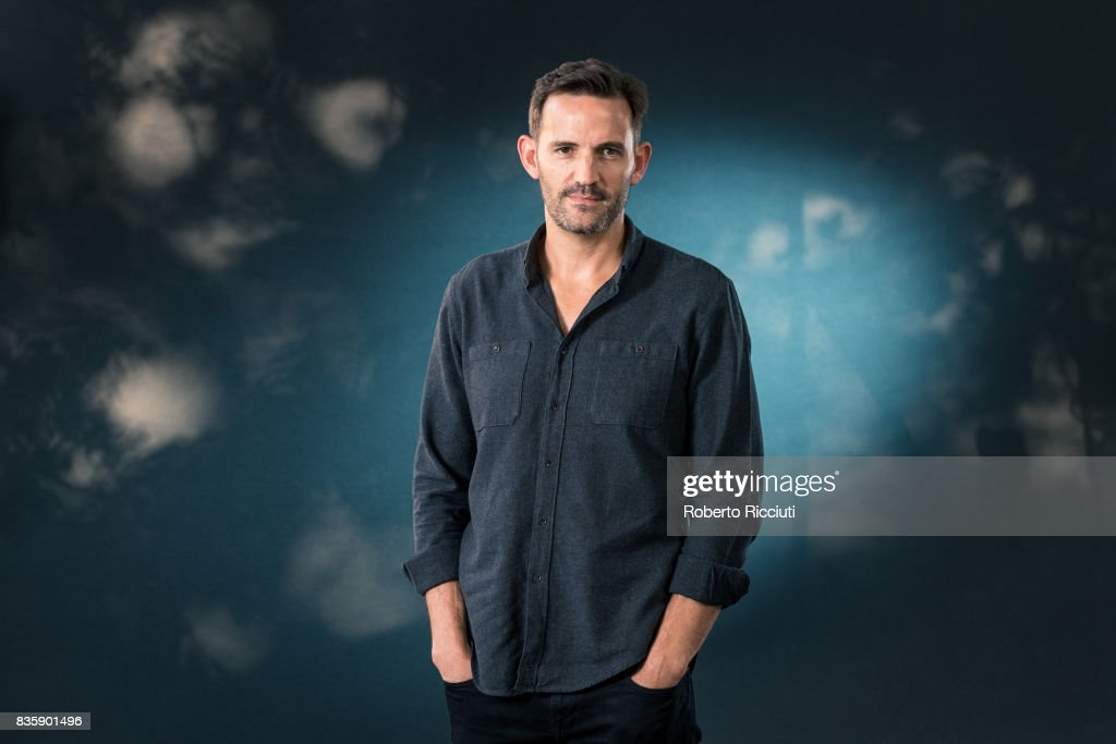 Scottish-South African author Jason Donald attends a photocall during the annual Edinburgh International Book Festival at Charlotte Square Gardens on August 20, 2017 in Edinburgh, Scotland.