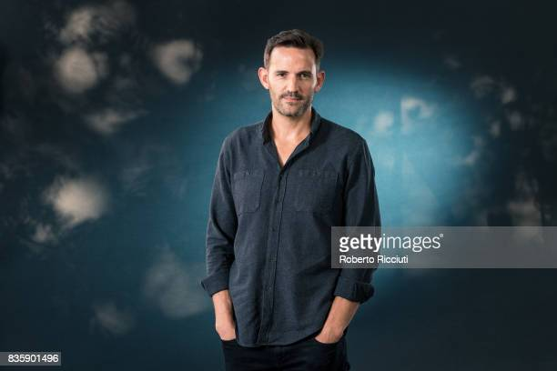 ScottishSouth African author Jason Donald attends a photocall during the annual Edinburgh International Book Festival at Charlotte Square Gardens on...