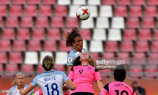 Scottland's midfielder Caroline Weir and England's midfielder Jill Scott go for a header during the UEFA Women's Euro 2017 football tournament match...