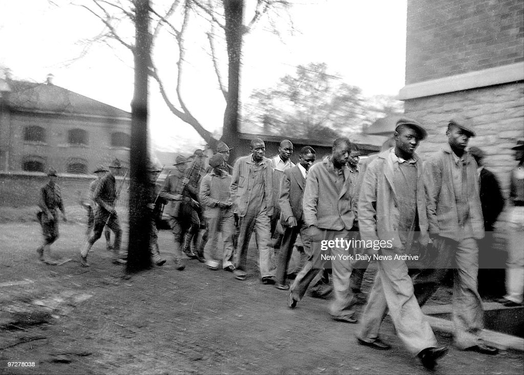 Scottsboro Case National Guardsmen bringing up the rear colored men defendants in famouse Scottsboro case march to courthouse in Decatur Alabama for...