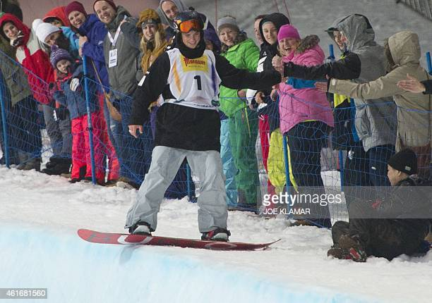 Scotty James of Australia celebrates his victory with fans during the Men's Snowboard Halfpipe competition of the FIS Freestyle and Snowboarding...