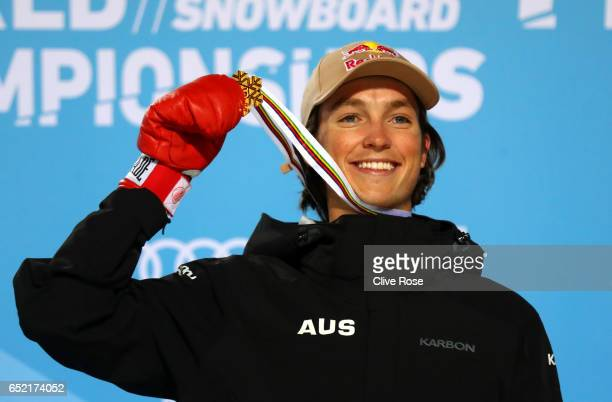 Scotty James of Australia celebrates winning the gold medal during the medal ceremony for the Men's Snowboard Halfpipe Final on day four of the FIS...