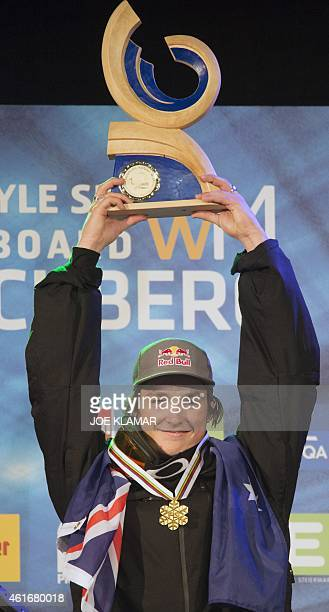 Scotty James of Australia poses with his trophy on the podium of the Men's Snowboard Halfpipe competition of the FIS Freestyle and Snowboarding World...