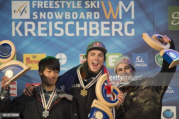 Scotty James of Australia Yiwei Zhang of China and TimKevin Ravnjak of Slovenia celebrate on the podium of the Men's Final of the Men's Snowboard...
