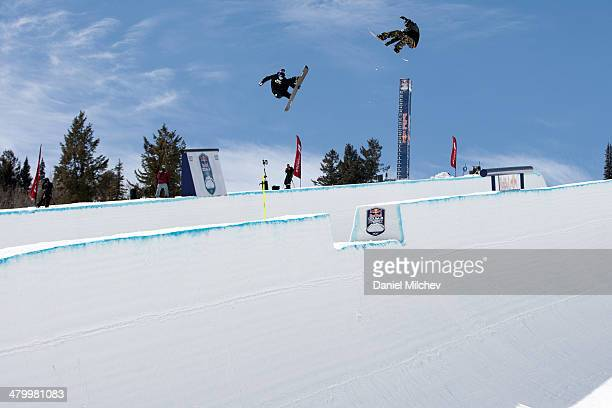 Scotty Lago and Louie Vito in action during practice at Red Bull Double Pipe on March 21 2014 in Aspen Colorado