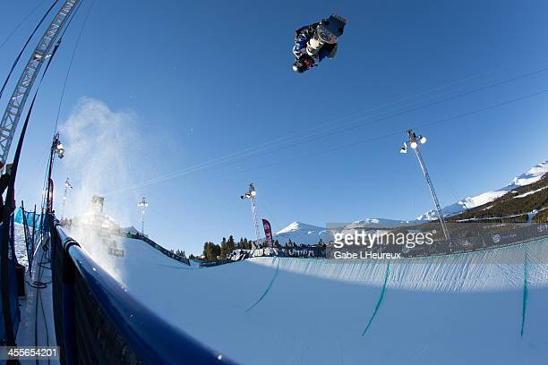 Scotty Lago mid air during halfpipe qualifiers in the 2013 Dew Tour on December 12 2013 in Breckenridge Colorado