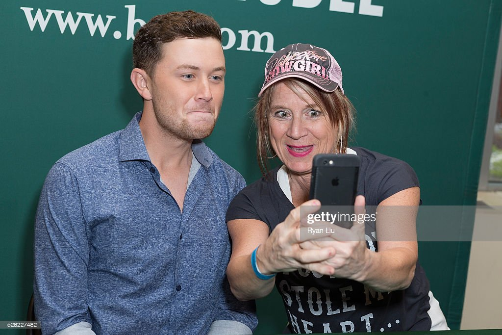 <a gi-track='captionPersonalityLinkClicked' href=/galleries/search?phrase=Scotty+McCreery&family=editorial&specificpeople=7520936 ng-click='$event.stopPropagation()'>Scotty McCreery</a> and fan attend his book signing event <a gi-track='captionPersonalityLinkClicked' href=/galleries/search?phrase=Scotty+McCreery&family=editorial&specificpeople=7520936 ng-click='$event.stopPropagation()'>Scotty McCreery</a> Signs Copies Of 'Go Big Or Go Home' at Barnes & Noble Citigroup Center on May 4, 2016 in New York City.