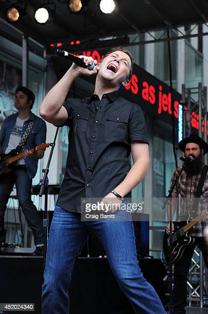 Scotty McCreery performs during 'FOX Friends' All American Concert Series outside of FOX Studios on July 11 2014 in New York City