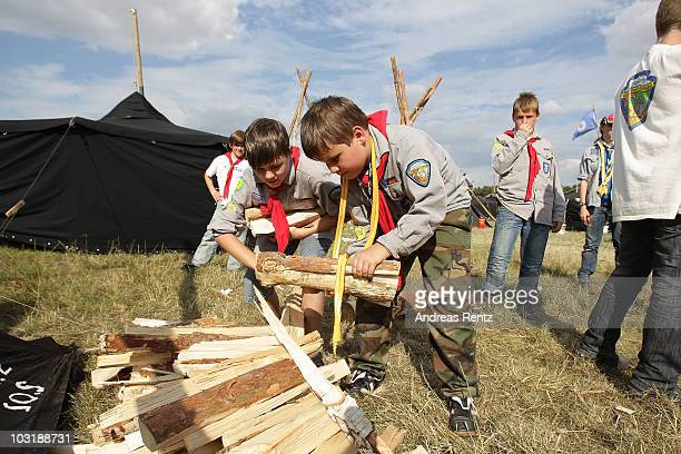 Scoust carry firewood at the camp on July 31 2010 in Almke near Wolfsburg Germany About 5000 young scouts from Germany Russia Belgium Suisse USA and...