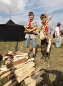 Scout carry firewood at the camp on July 31 2010 in Almke near Wolfsburg Germany About 5000 young scouts from Germany Russia Belgium Suisse USA and...
