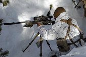 January 24, 2011 - A scout sniper prepares his shot on target during the Mountain Scout Sniper Course at Marine Corps Mountain Warfare Training Center, California.