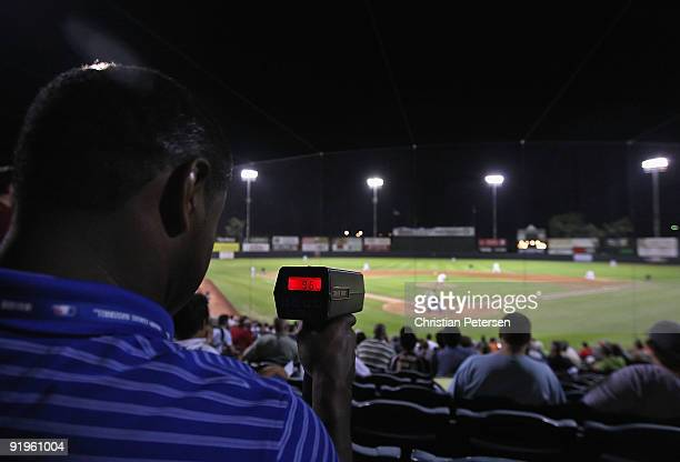 A scout uses a speed gun to track Washington Nationals prospect Stephen Strasburg playing for the Phoenix Desert Dogs during the Arizona Fall League...