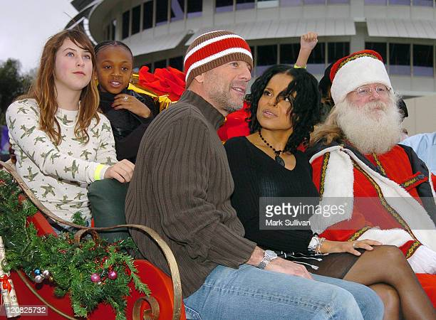 Scout Willis a guest Bruce Willis and Victoria Rowell with Santa Claus