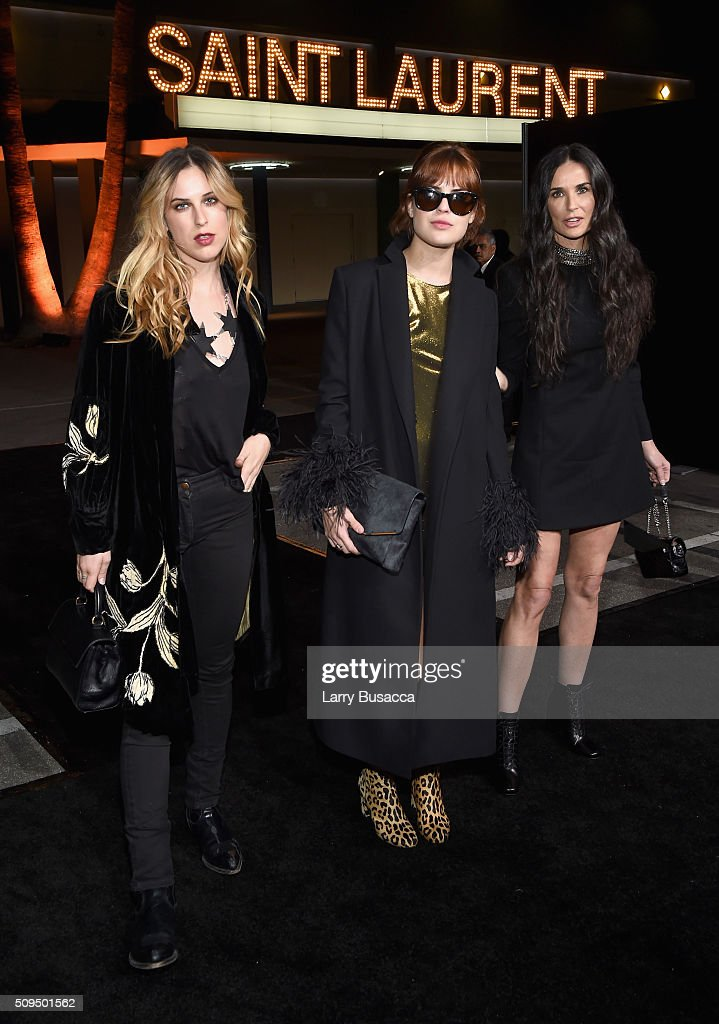 Scout Willis, model Tallulah Willis and actress Demi Moore, in Saint Laurent by Hedi Slimane, attend Saint Laurent at the Palladium on February 10, 2016 in Los Angeles, California for the Saint Laurent Los Angeles show.