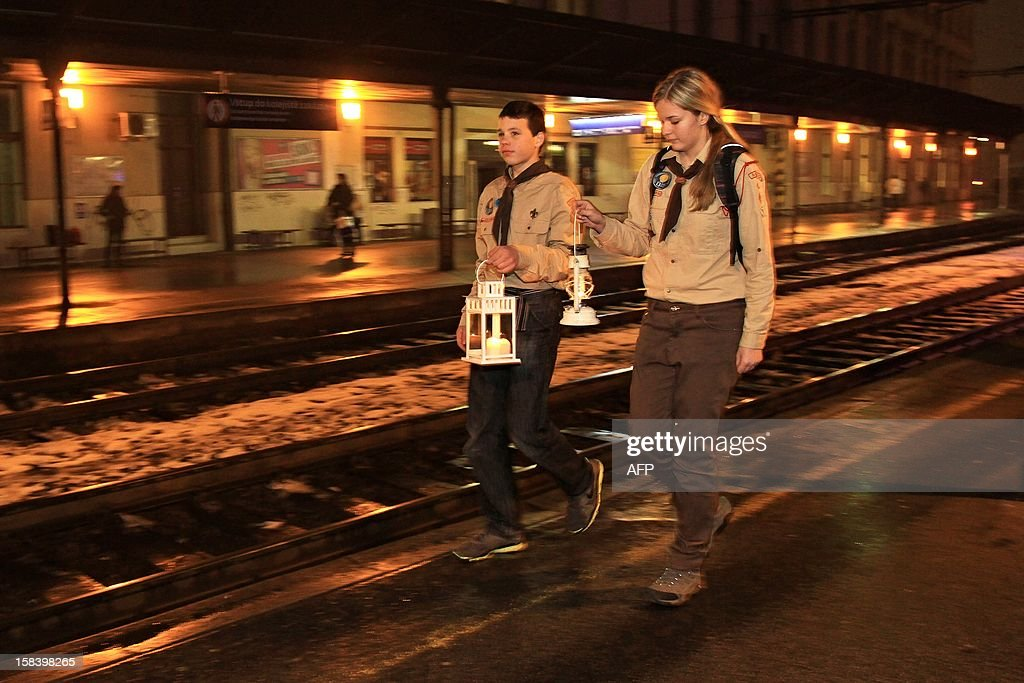 Scouts arrive by train from Vienna for the traditional symbol of Christmas, the Bethlehem light In Brno, on December 15, 2012. The light will be taken by the scouts by trains throughout the Czech Republic. Brno is the first city in the Czech Republic where the Bethlehem light is brought. MICA