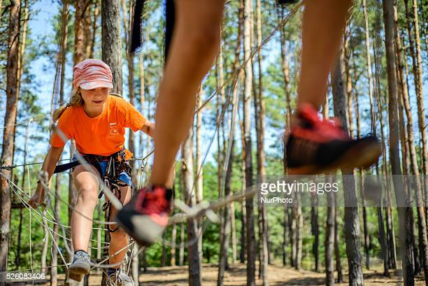 Scouts climbing on a high ropes course in Ukrainian scout training camp Kiev region Ukraine