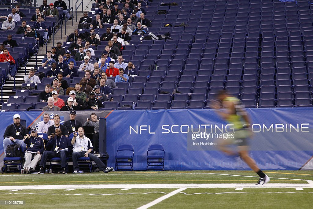 Scouts look on as a player runs the 40yard dash during the 2012 NFL Combine at Lucas Oil Stadium on February 28 2012 in Indianapolis Indiana