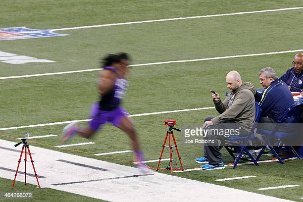 Scouts time the 40yard dash of defensive back Josh Shaw of USC during the 2015 NFL Scouting Combine at Lucas Oil Stadium on February 23 2015 in...