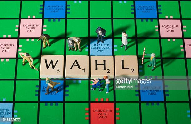 Scrabble game board with the term WAHL and figures