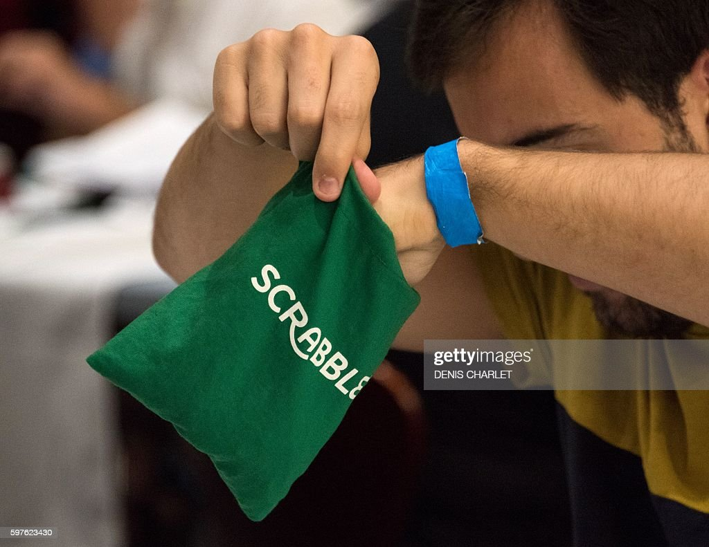 A Scrabble player pulls letters from a sack during the World Scrabble Championships on August 29 2016 at the Grand Palais in Lille The World Scrabble...