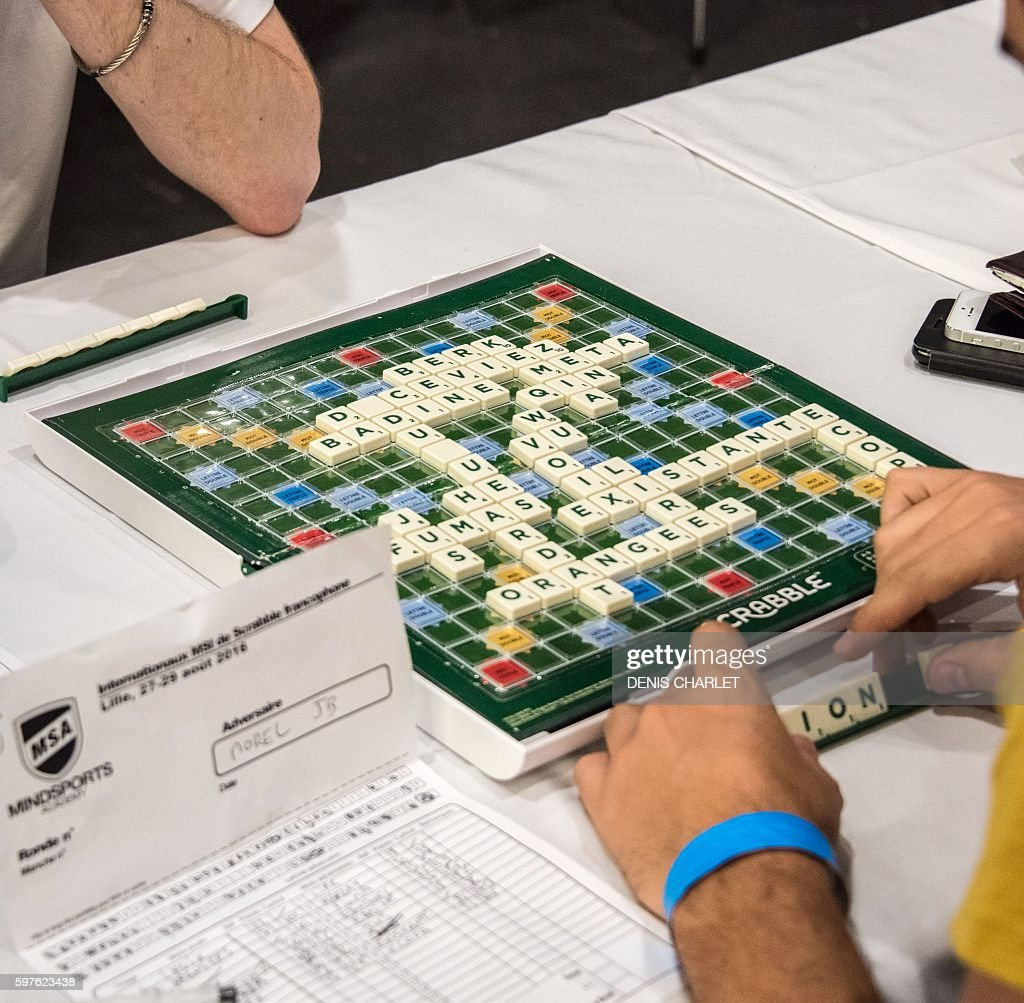 Scrabble players choose a word during the World Scrabble Championships on August 29 2016 at the Grand Palais in Lille The World Scrabble...