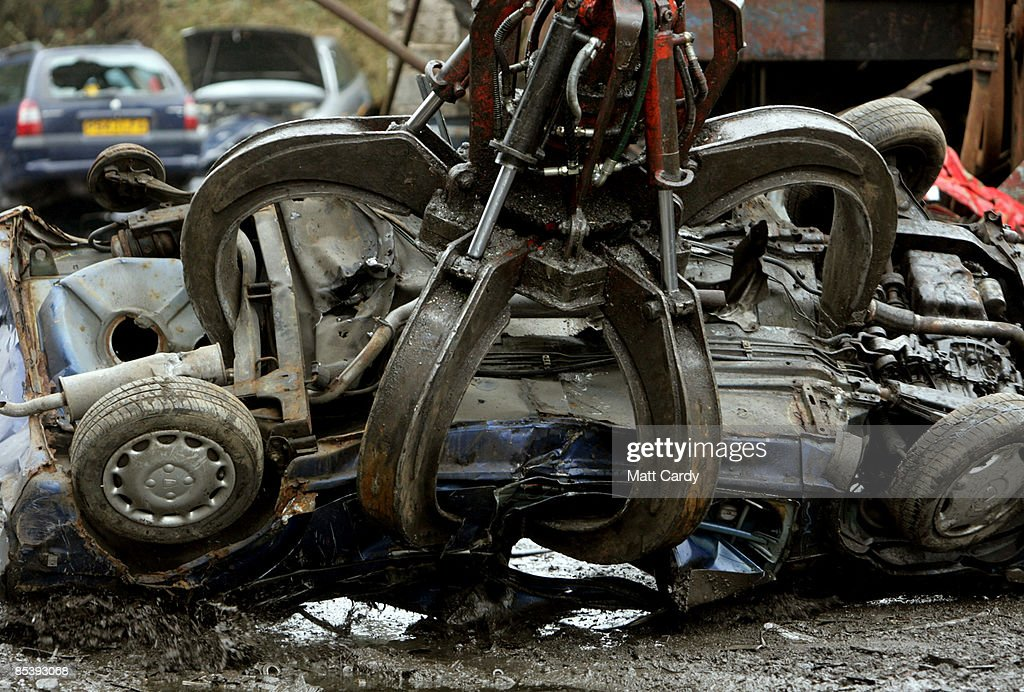 A scrap car is dragged by a mechanical dragger as it is processed in a car dismantlers and scrapyard on March 12 2009 in Radstock England Government...