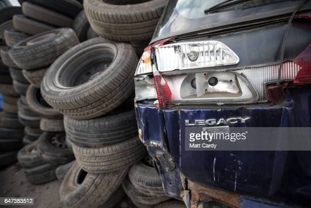 A scrap car is surrounded by old tyres at Pylle Motor Spares and Metal Processing a licensed scrap yard in Pylle near Shepton Mallet on March 2 2017...