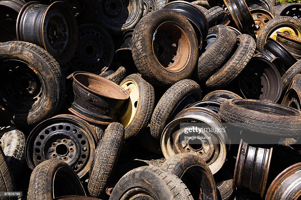 Scrap car tires and rims : Stock Photo