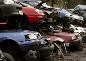 Scrap cars wait to be broken up for spares before being processed in a car dismantlers and scrapyard on March 12 2009 in Radstock England Government...