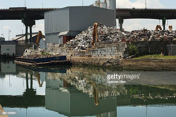 A scrap heap sits next to the polluted Gowanus Canal on June 2 2009 in the Brooklyn borough of New York City The Gowanus Canal is bounded by several...