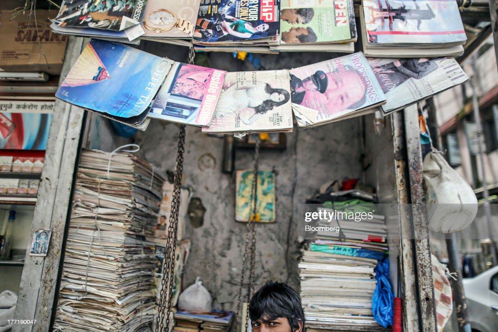 A scrap paper dealer sits at a stall in Mumbai, India, on Wednesday, Aug. 21, 2013. The prospect of an indecisive 2014 election in India is eroding confidence among global investors that the government can stop the rupees worst drop in more than two decades. Photographer: Dhiraj Singh/Bloomberg via Getty Images