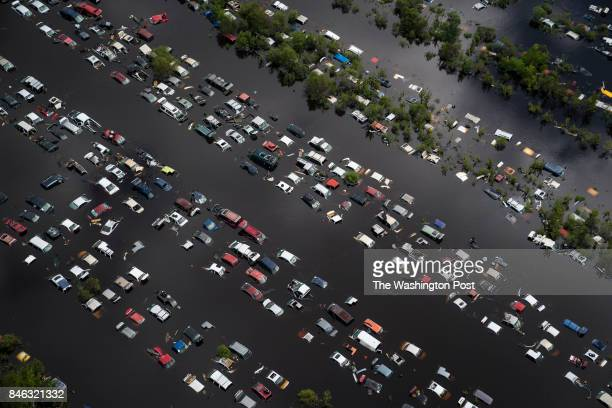 A scrap yard full of vehicles is seen covered by flood water in the aftermath of Hurricane Irma in Callahan Fla on Tuesday Sept 12 2017