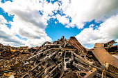 Garbage dump of metal and iron. Blue sky
