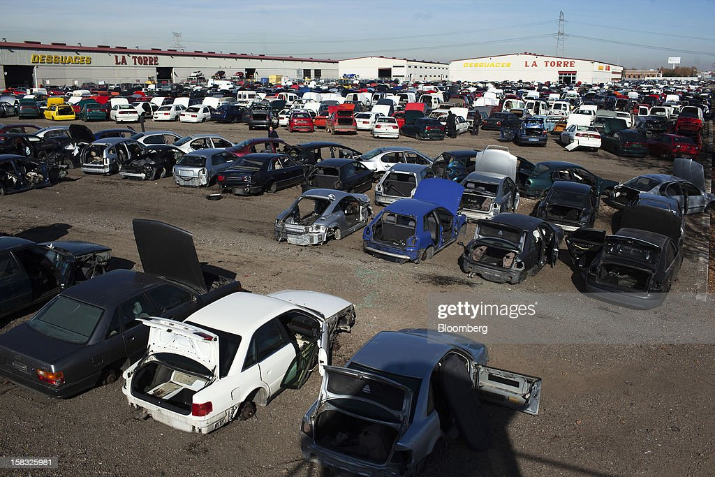 Scrapped automobiles used for spare parts stand in the yard of the Desguaces La Torre scrapyard in Madrid, Spain, on Thursday, Dec. 13, 2012. Spain has completed the debt sales it planned for this year and started raising funds for 2013, buying time for Prime Minister Mariano Rajoy as he decides whether to seek a European bailout. Photographer: Angel Navarrete/Bloomberg via Getty Images