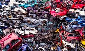 Scrapped cars stacked on a scrap yard. Car recycling